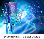 a microphone on a blue... | Shutterstock .eps vector #1126529231