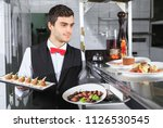 the waiter with the ready... | Shutterstock . vector #1126530545