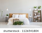 white pillows on wooden bed in... | Shutterstock . vector #1126541804