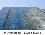 wall of a modern skyscraper... | Shutterstock . vector #1126556081