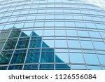 wall of a modern skyscraper... | Shutterstock . vector #1126556084