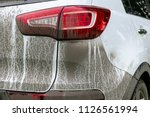 back view of a very dirty car.... | Shutterstock . vector #1126561994