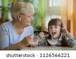 senior grandmother with... | Shutterstock . vector #1126566221