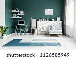 blue carpet in spacious green... | Shutterstock . vector #1126585949