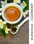 jasmine tea in a white cup with ... | Shutterstock . vector #1126586369