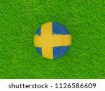 sweden flag on football on... | Shutterstock . vector #1126586609