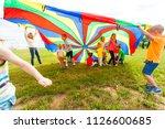 happy kids waving rainbow... | Shutterstock . vector #1126600685