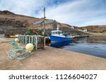 fishing boats in the harbour at ... | Shutterstock . vector #1126604027