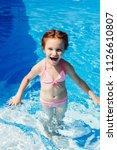 laughing little child in bikini ... | Shutterstock . vector #1126610807
