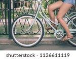 closeup woman riding by blue...   Shutterstock . vector #1126611119