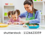 happy mother and daughter are... | Shutterstock . vector #1126623359