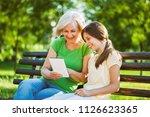 grandmother and granddaughter... | Shutterstock . vector #1126623365
