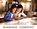 glad mother and daughter... | Shutterstock . vector #1126652147