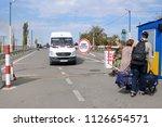 ukrainian russian border. woman ... | Shutterstock . vector #1126654571