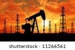 oil rig silhouettes over orange ... | Shutterstock . vector #11266561