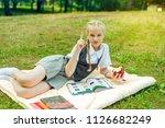 schoolgirl in uniform shows... | Shutterstock . vector #1126682249
