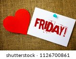 Conceptual hand writing showing Friday Motivational Call. Business photo text Last day of working week Start weekend Relax time Message note jute background red heart letters love grunge idea.