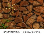 this firewood stack was...   Shutterstock . vector #1126712441