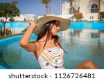 summer time.  girl in a hat... | Shutterstock . vector #1126726481