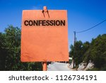 Small photo of Conceptual hand writing showing Confession. Business photo text Admission Revelation Disclosure Divulgence Utterance Assertion Wooden board post ideas blue sky trees antique vintage landscape.