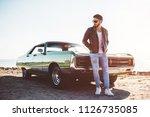 handsome bearded man is... | Shutterstock . vector #1126735085