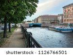the blue bridge over the moika... | Shutterstock . vector #1126766501