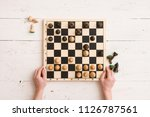 top view on wooden chess board... | Shutterstock . vector #1126787561