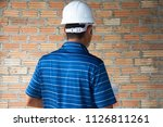 young engineering on wall  | Shutterstock . vector #1126811261