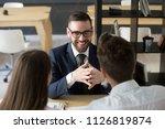 smiling insurance agent... | Shutterstock . vector #1126819874
