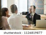 smiling male realtor or broker... | Shutterstock . vector #1126819877