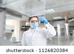 female scientist looking at the ... | Shutterstock . vector #1126820384