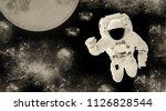 astronaut in a spacesuit in... | Shutterstock . vector #1126828544