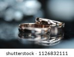 two gold wedding rings with... | Shutterstock . vector #1126832111