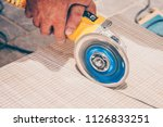 finishing works   the tiler... | Shutterstock . vector #1126833251