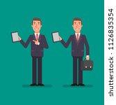 businessman holds tablet holds... | Shutterstock .eps vector #1126835354
