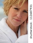 close up of blond woman wearing ... | Shutterstock . vector #112687931