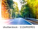 blurred road texture. fast... | Shutterstock . vector #1126903901