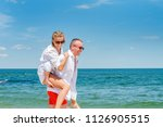 happy couple in love on beach... | Shutterstock . vector #1126905515