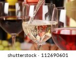 white wine pouring into a wine...   Shutterstock . vector #112690601