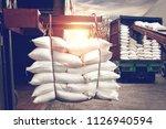 forklift handling white sugar... | Shutterstock . vector #1126940594