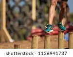mud race runners during extreme ...   Shutterstock . vector #1126941737