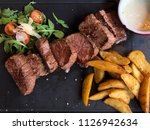 veal slices with salad  french... | Shutterstock . vector #1126942634