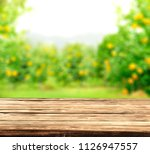 table space of wood and summer... | Shutterstock . vector #1126947557