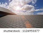 Slate Roof House With Blue Sky...