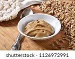 a dish of sunflower seed butter ... | Shutterstock . vector #1126972991