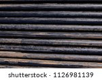 oil drill pipe. rusty drill... | Shutterstock . vector #1126981139