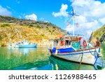 boats in a port in one of greek'... | Shutterstock . vector #1126988465