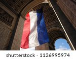 french flag at the arc de... | Shutterstock . vector #1126995974
