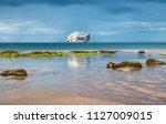 rain and bass rock reflections... | Shutterstock . vector #1127009015