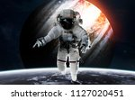 jupiter with astronaut in front ... | Shutterstock . vector #1127020451